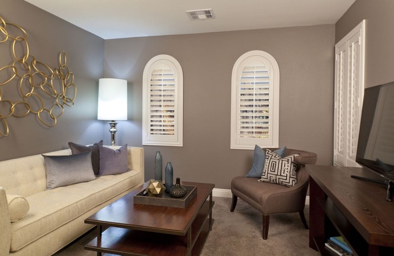 Miami family room with arch plantation shutters.