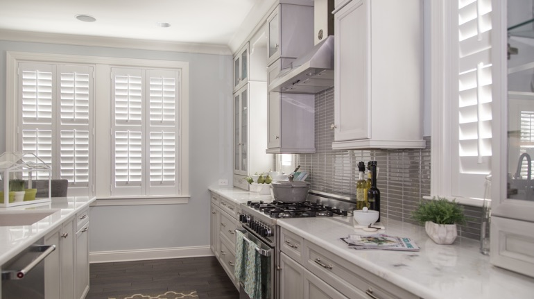 White shutters in Miami kitchen with modern appliances.