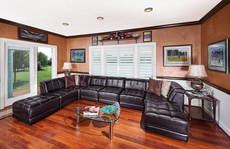 Miami basement with slider doors and plantation shutters.