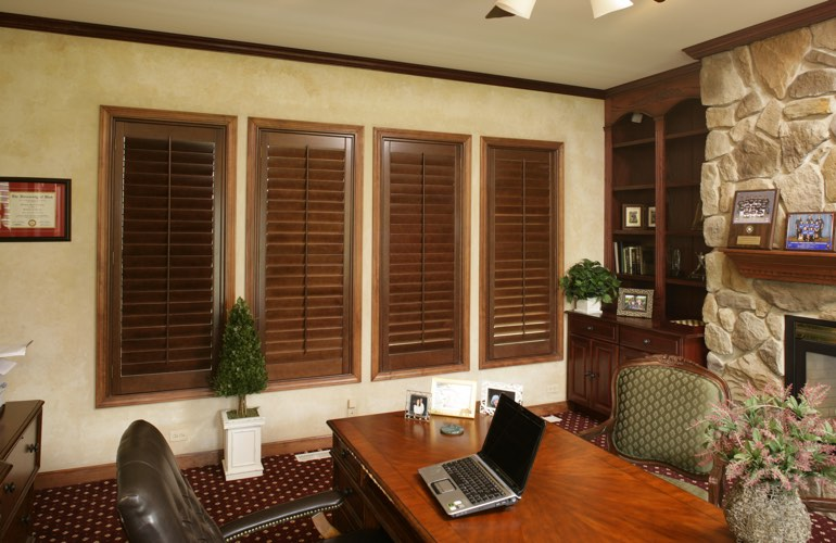 Hardwood plantation shutters in a Miami home office