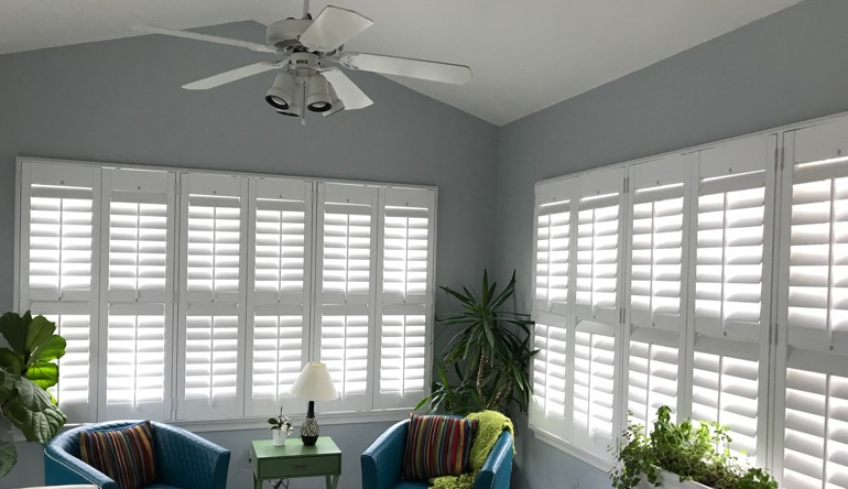 Miami sunroom with fan and shutters