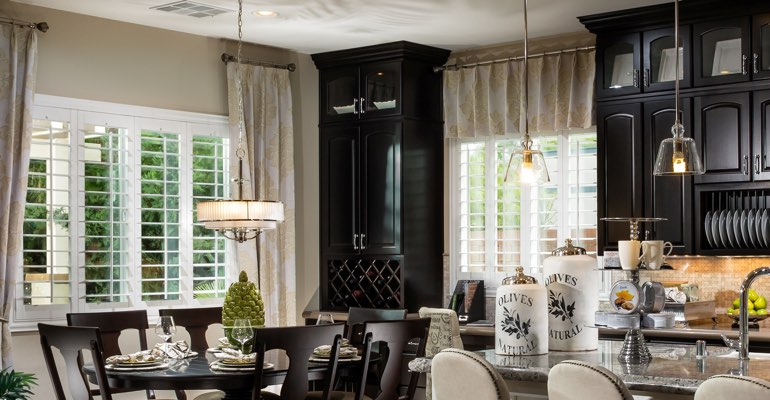 Miami kitchen dining room with plantation shutters.