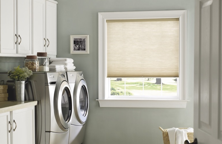 Miami laundry room with pull-down window shades.