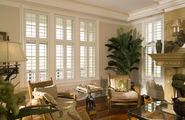 Living Room in Miami with interior plantation shutters.
