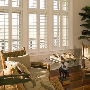 Miami living room polywood shutters.