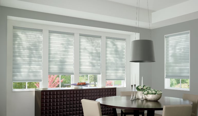 Cellular shades in a Miami dining room.