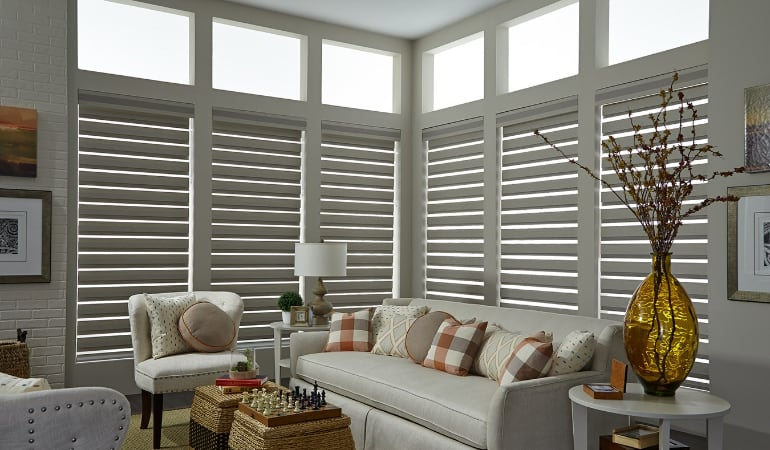 Motorized shades in a Miami living room.