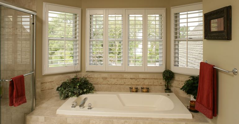 Plantation shutters in Miami bathroom.