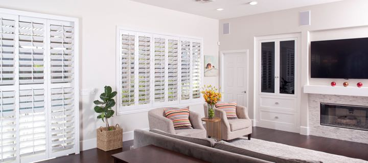Miami living room in white with plantation shutters.