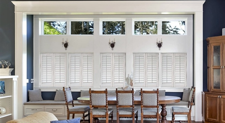 Shut classic plantation shutters in Miami dining room.
