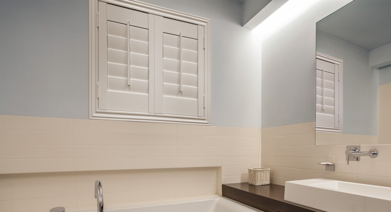 Studio waterproof shutters in Miami bathroom.