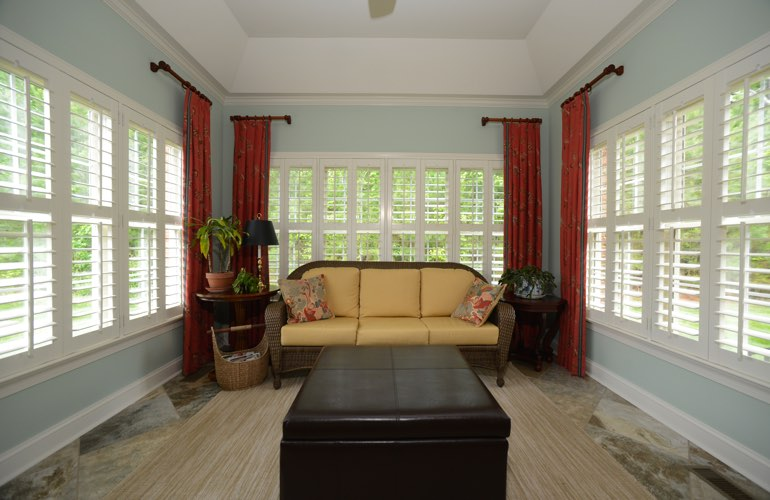 Miami sunroom with beautiful window shutters.
