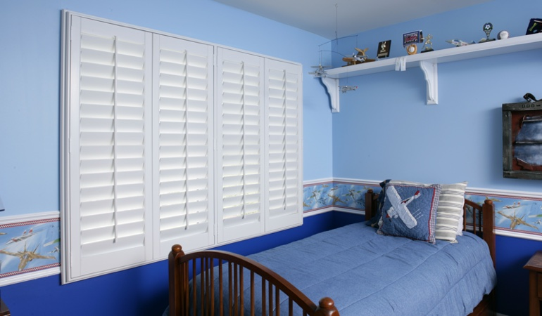 White plantation shutters in blue kids bedroom in Miami