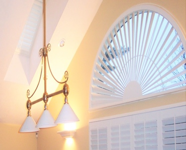 Miami arched eyebrow window with plantation shutter