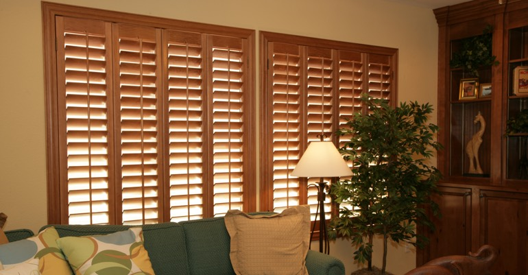 Natural wood shutters in Miami living room.