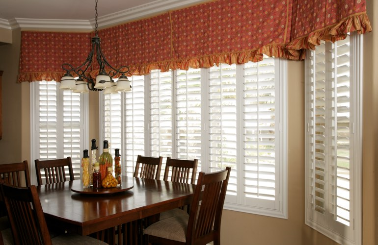 Plantation shutters on wide kitchen windows